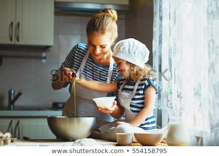 Mother and daughter rolling out pastry Stock photo © photography33