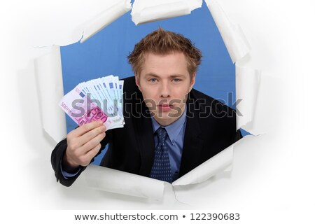 An arrogant businessman successfully breaking into a market Stock photo © photography33