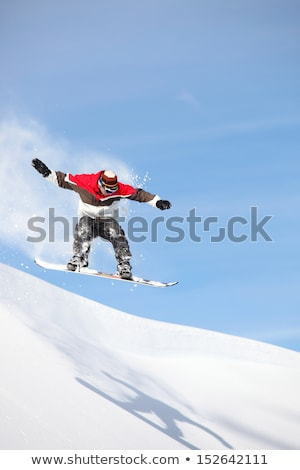 Snowboarder performing impressive jump Stock photo © photography33