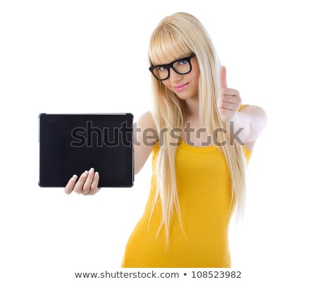 beautiful woman holding tablet giving thumbs up stock photo © dmitri_gromov
