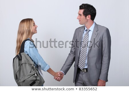 Jonge student handen schudden man pak meisje Stockfoto © photography33