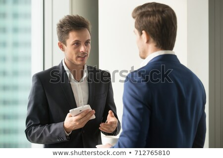 businessman explaining his work to colleague stock photo © photography33
