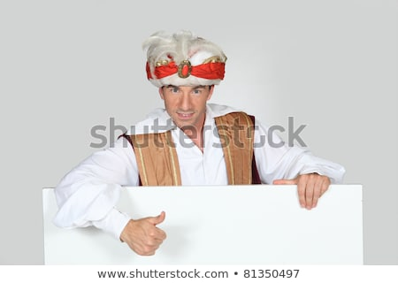 Man in a fancy dress turban giving the thumbs up to a board left blank for your image Stock photo © photography33