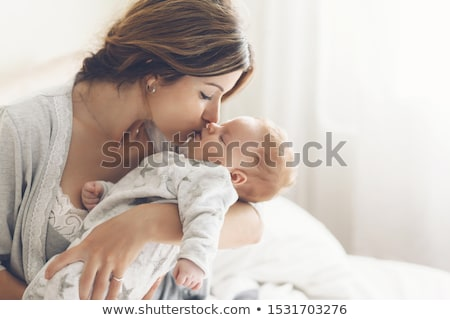 baby and mama Stock photo © dolgachov