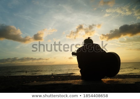 Young man with guitar playing rock music Stock photo © photography33