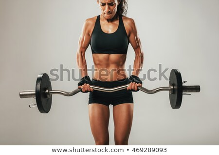 Mulher jovem barbell esportes fitness clube exercer Foto stock © photography33