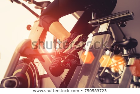 female riding a bike in the gym Stock photo © photography33