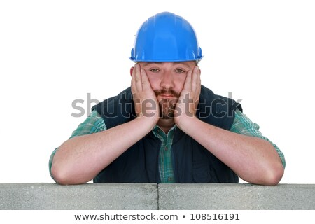 A fed-up and bored tradesman Stock photo © photography33