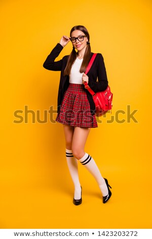 charming young teenage girl ready to attend college stock photo © stockyimages