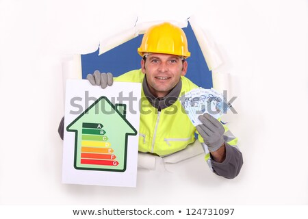 Laborer with energy rating sign Stock photo © photography33