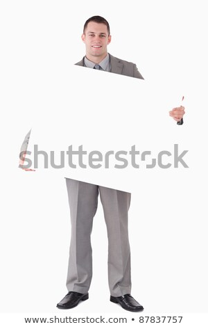 Portrait of a businessman holding a blank panel against a white background Stock photo © wavebreak_media