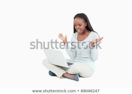 Jonge vrouw vloer negatieve verwonderd laptop witte Stockfoto © wavebreak_media