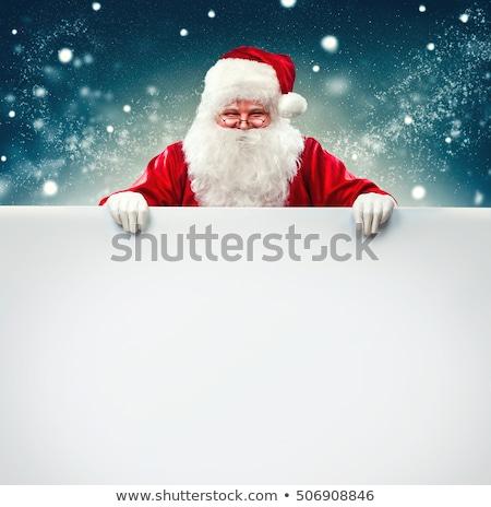 Mikulás kéz tart üres tábla kártya ünnepi Stock fotó © Lightsource