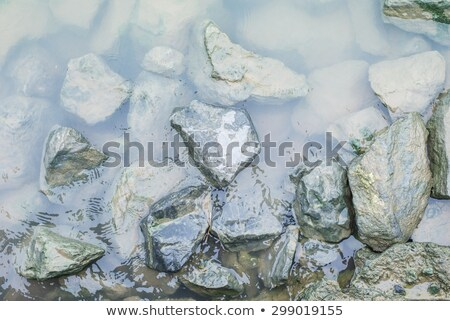 Stock photo: Smooth Pebble Stones In Water