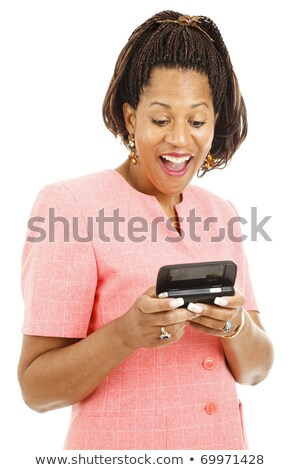 Woman laughing as she reads a text message Stock photo © stryjek