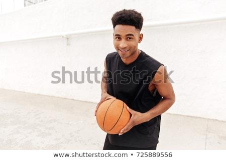 Jonge toevallig jongen spelen basketbal witte Stockfoto © wavebreak_media