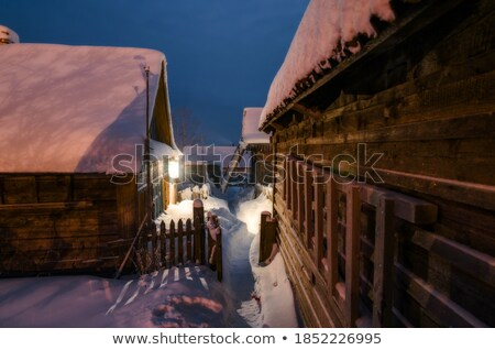 snow on wood beams in winter time stock photo © lunamarina