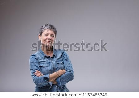 Mulher dobrado brasão jovem loiro câmera Foto stock © fantasticrabbit