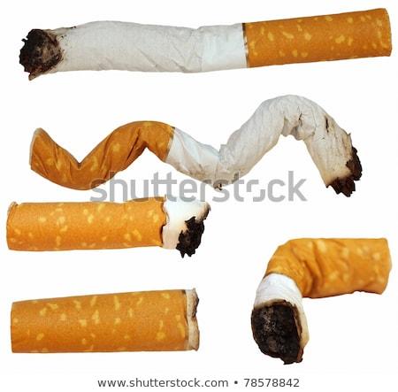 Twee sigaret uit grond paar voeten Stockfoto © silkenphotography