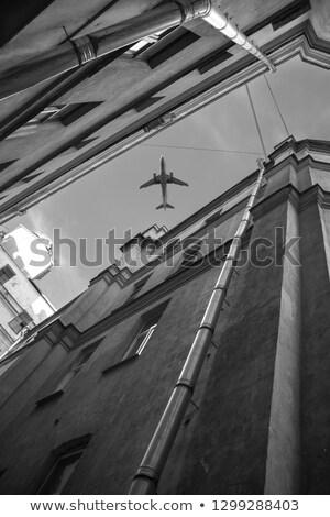 aircraft over houses stock photo © geribody