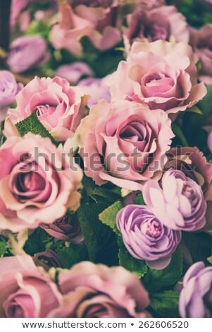 Fake fabric roses in basket Stock photo © stoonn