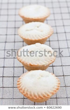 Four freshly baked mini apple pies Stock photo © raphotos