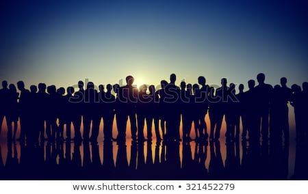 People standing and rowing at sunset Stock photo © xuanhuongho