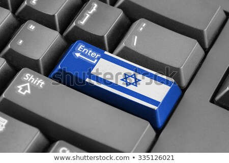 Israel - Flag on Button of Black Keyboard. Stock photo © tashatuvango