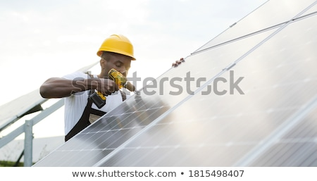 man making the construction for the solar panels stock photo © compuinfoto