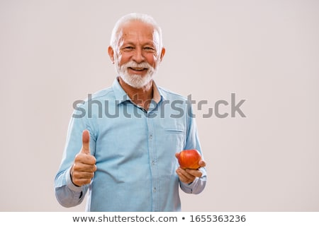 man eating an apple stock photo © meinzahn