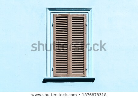 Italian style wooden window with closed shutter blinds Stock photo © stevanovicigor