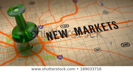 Stock fotó: New Markets - Green Pushpin On A Map Background