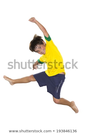 Chłopca skoki żółty niebieski piłka nożna zespołu Zdjęcia stock © BrazilPhoto
