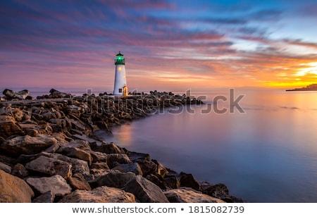 Farol lago praia madeira pôr do sol mar Foto stock © Kayco