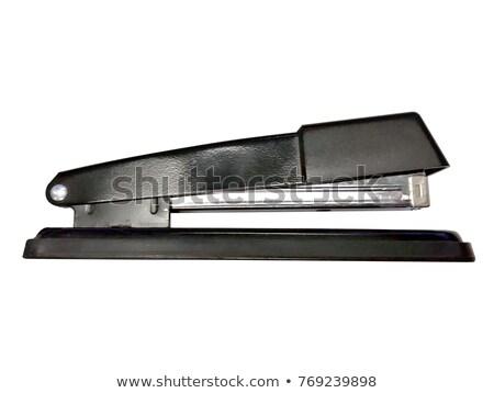 profile of black stapler isolated on a white background stock photo © bmonteny