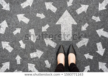 businesswoman with road sign stock photo © cherezoff