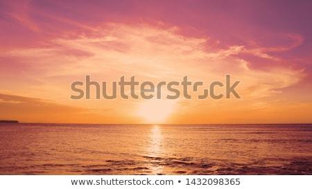 Pôr do sol praia vermelho céu pôr do sol paisagem Foto stock © franky242