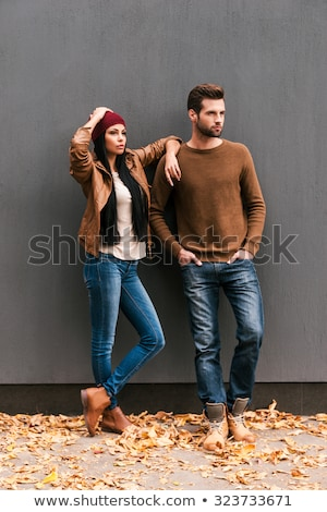 young fashion couple looking away from the camera stock photo © feedough