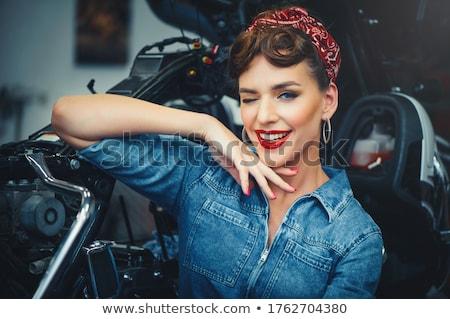 Beautiful girl mechanic with wheel Stock photo © Aleksangel