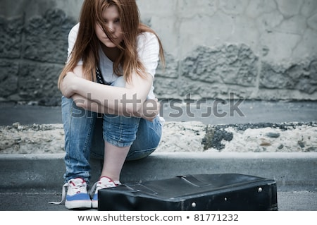 Pretty girl sits on old suitcase Stock photo © Aikon