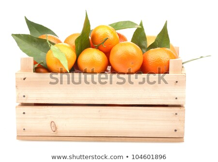 fresh tangerines in wooden box stock photo © karaidel
