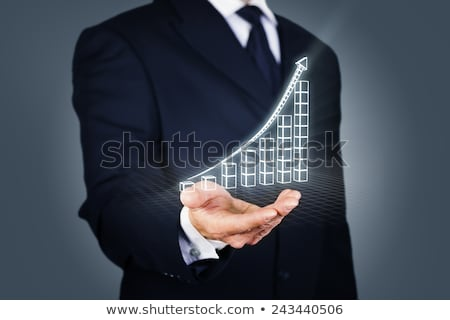Stok fotoğraf: Businessman With A Rising Chart In Wireframe Mode