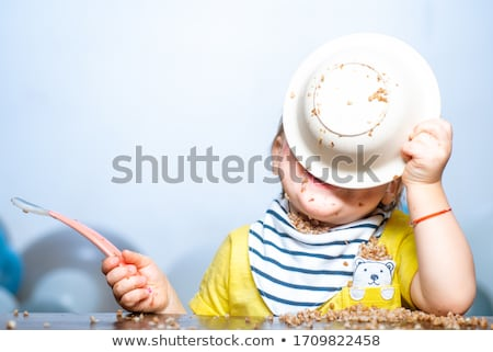 infant eats messy stock photo © phakimata