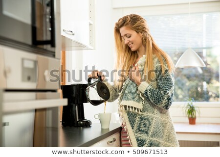 woman pours coffee into cup Stock photo © fotoaloja