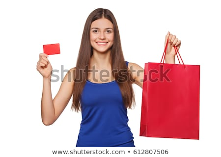 pretty woman holding shopping bags and showing blank credit card stock photo © master1305