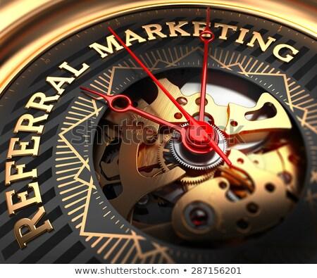 Referral Marketing on Black-Golden Watch Face. Stock photo © tashatuvango