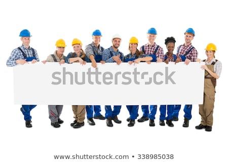 Foto stock: Sorridente · handyman · quadro · de · avisos · retrato · branco · homem