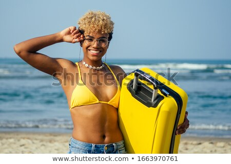 Pretty girl in swimming suit with suitcase Stock photo © Aikon