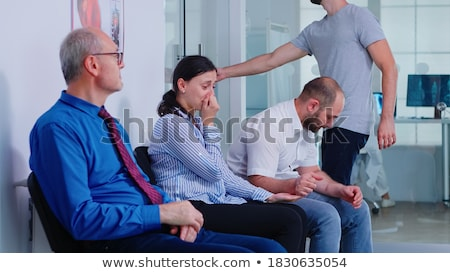 Doctor talking to crying patient after tests Stock photo © HASLOO