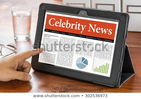A tablet computer on a desk - Celebrity News Stock photo © Zerbor